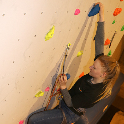 ready2climb: a female lead climber clipping a quickdraw