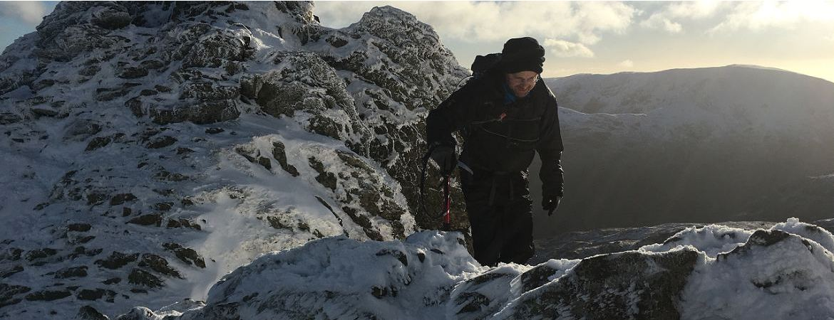 ready2climb: a man walking along Striding Edge, Helvellyn in the English Lake District in winter