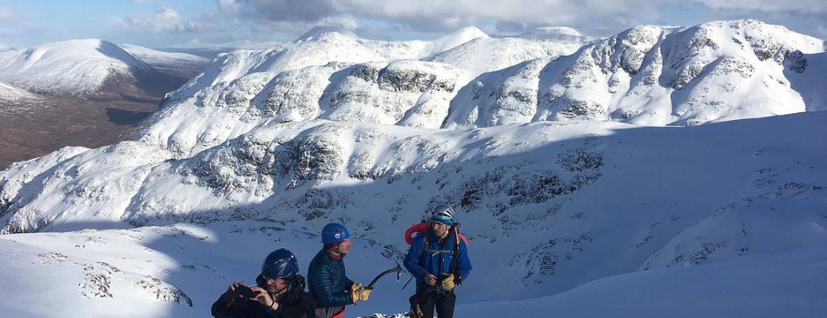ready2climb: Mountaineers stood on top of a snow covered mountain in Glencoe, Highlands, Scotland