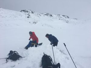 ready2climb: two walkers digging a temporary snow shelter