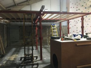 ready2climb: a steel framework showing wooden joists and floor ply sheets