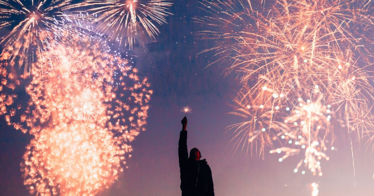 ready2climb: a stock image of a man celebrating with fireworks