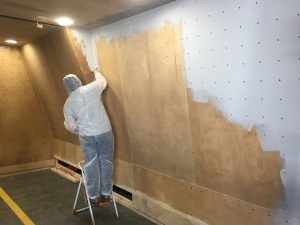 ready2climb: a worker in PPE prepares a climbing surface for painting