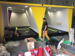 ready2climb: black pvc covered mats form the base of a bouldering area