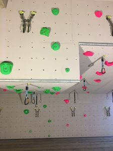 ready2climb: a climbing headwall showing lower-off chains and routes made from plastic climbing holds
